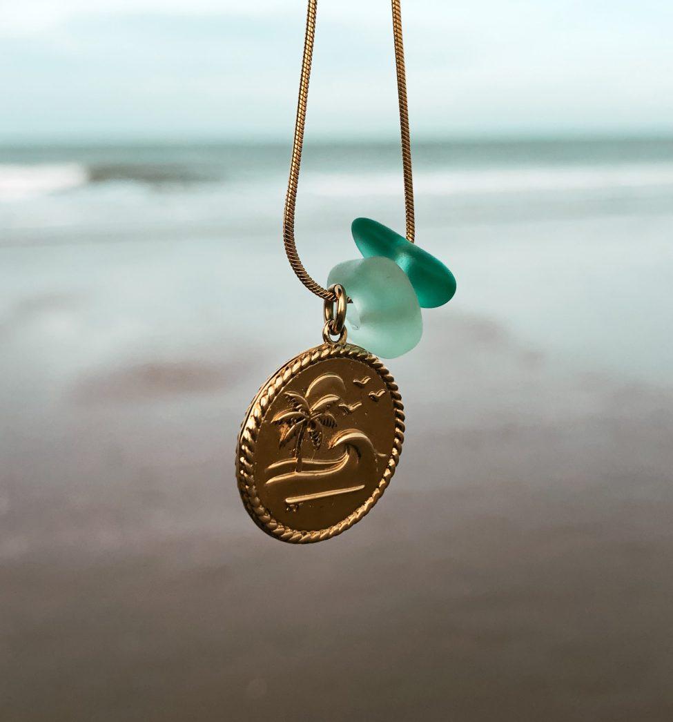 zeeglas goud munt bedel hanger